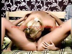 Блондинка с маленькими сиськами сосёт фаллос и трахается с грудастой лесбиянкой